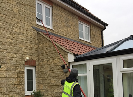 Man cleaning residential cleaning. AMac Window Cleaning, window cleaning, Chippenham, Calne, Corsham, Devizes, Marlborough, Melksham, Trowbridge